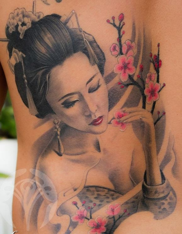 Lovely geisha with flower tattoo on back
