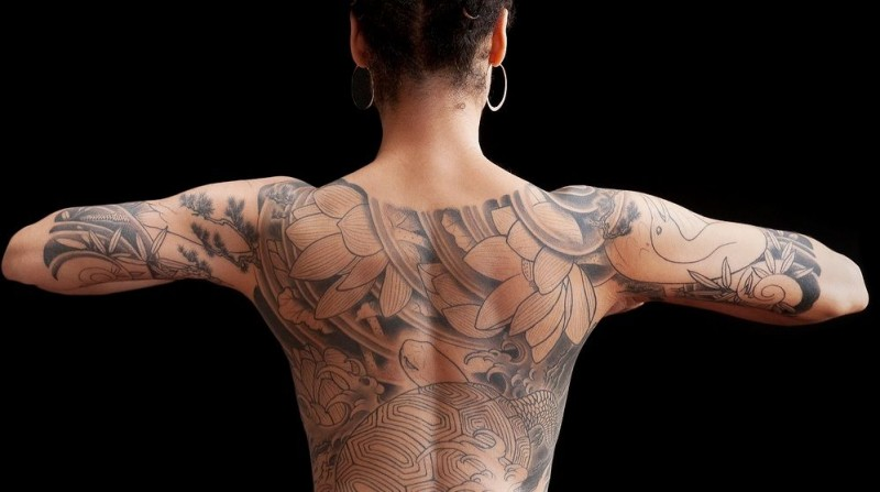 Lovely japanese style tattoo on back and half sleeve for women