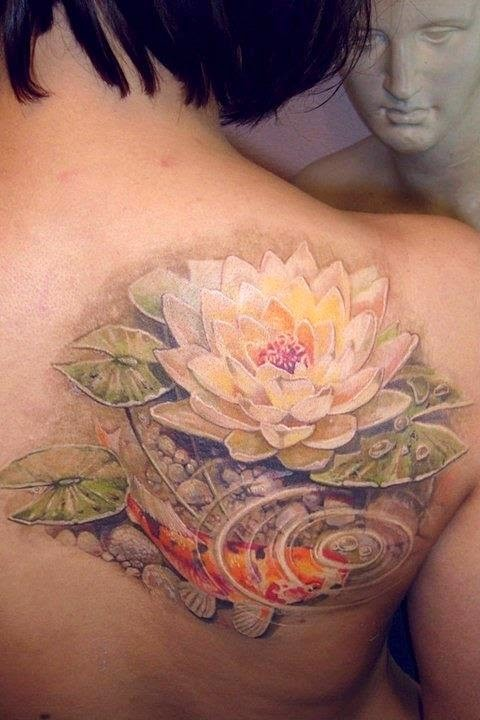 38d663ac9c056 Lovely koi fish and lotus tattoo on shoulder blade - Tattooimages.biz