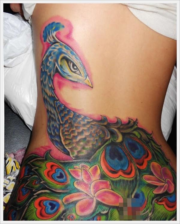 Lovely peacock tattoo on lower back for girls
