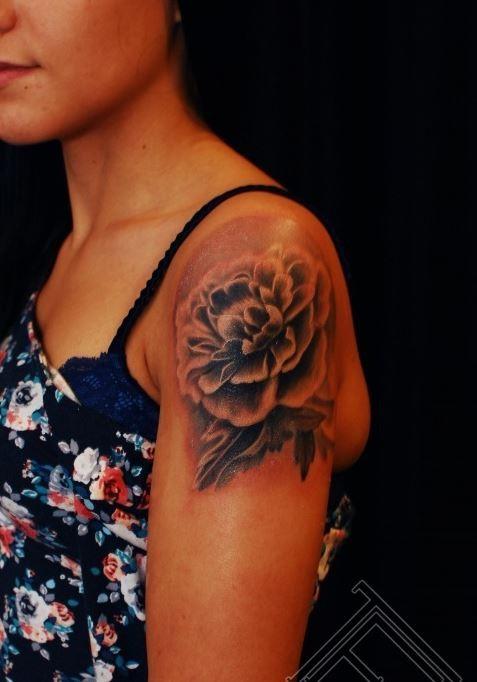 Lovely peony flower tattoo on shoulder