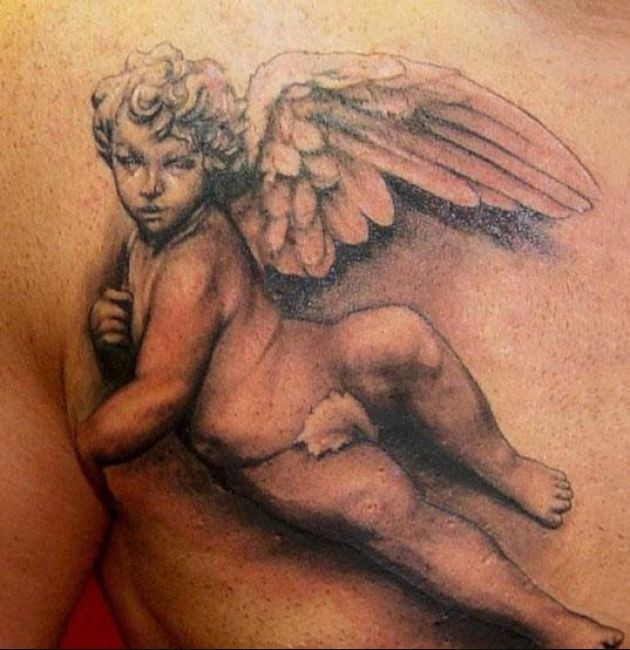 Lovely realistic cherub tattoo on chest for men