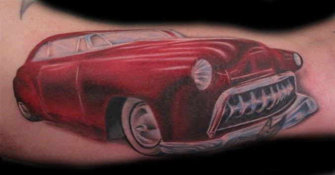 Lovely red car tattoo on arm