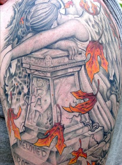 Lovely sad angel and tombstone tattoo