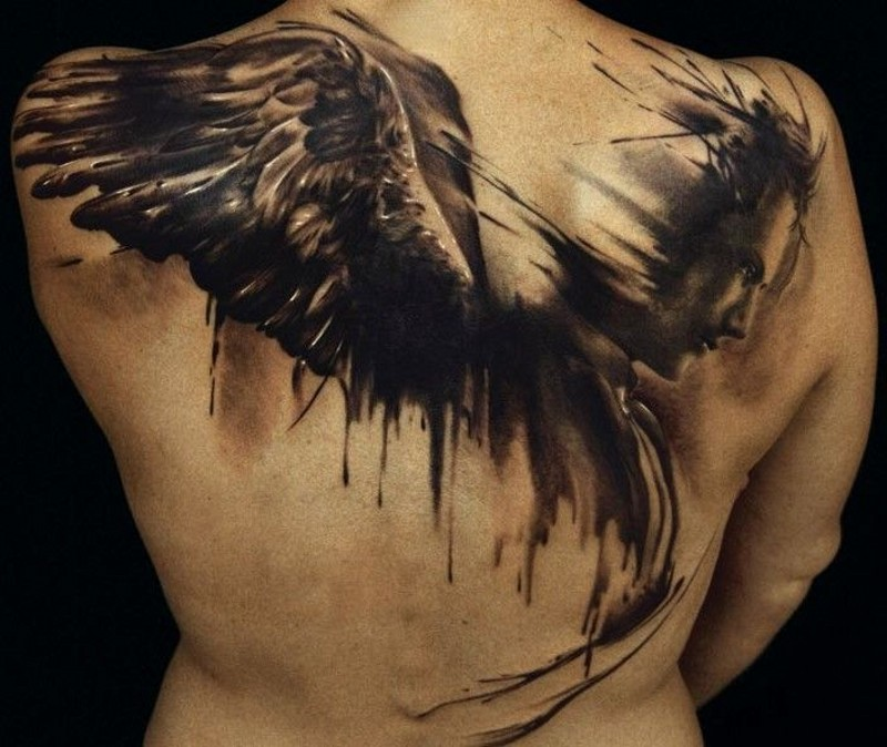 Lovely watercolor angel tattoo on back