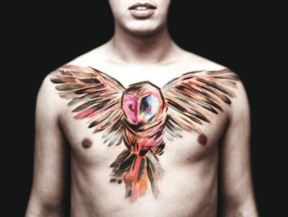 Lovely watercolor big owl tattoo on chest