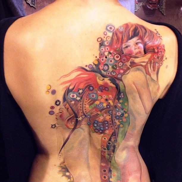 Lovely watercolor girls tattoo on back