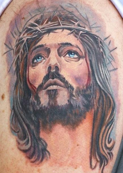 Lovely watercolor jesus tattoo on shoulder