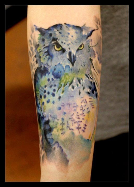 Lovely watercolor owl tattoo on arm