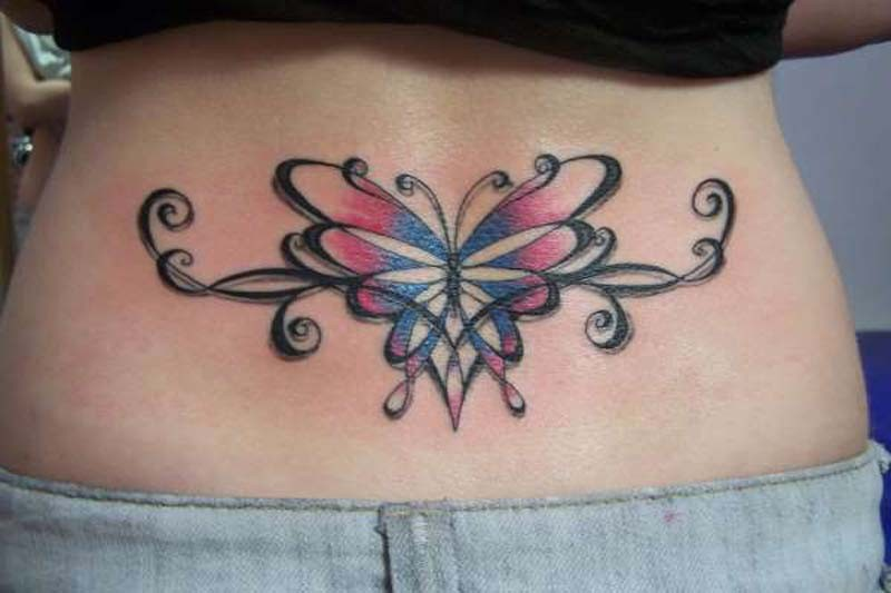 Lower back colored tribal butterfly tattoo with pattern
