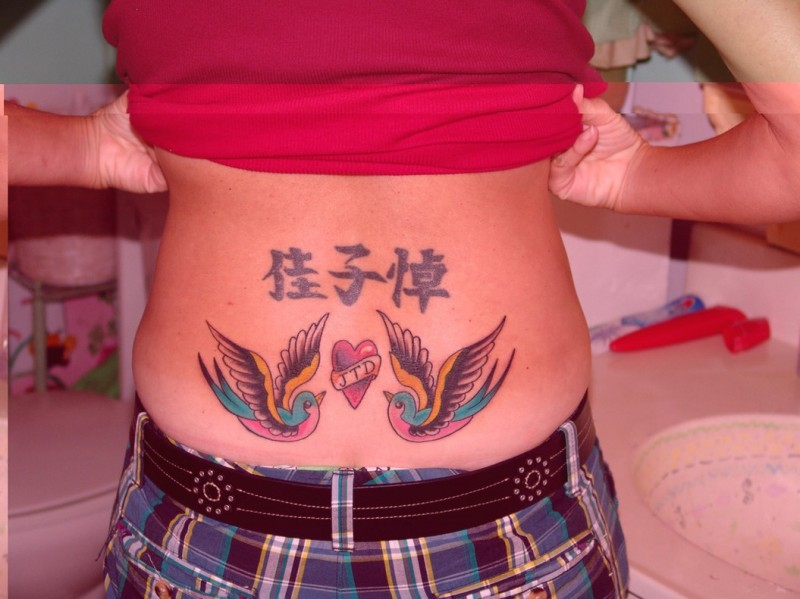 Lower back tattoo with chinese characters and birds in color