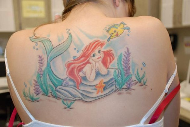 Magical cartoon scene Ariel and Flounder at sea bottom pale naturally colored back tattoo
