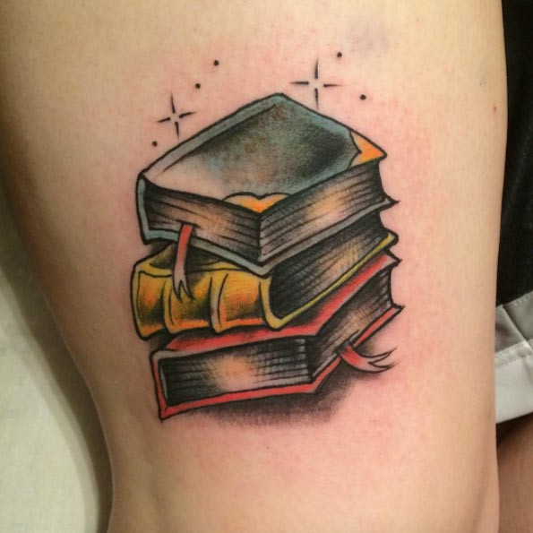 Magical pale of old colored books detailed tattoo in old school style