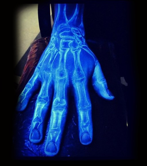 Magical white ink luminescence hand bones tattoo on hand and arm