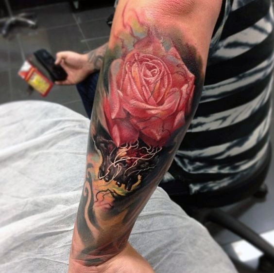 Magnificent 3D style big colored detailed rose tattoo on forearm with skull