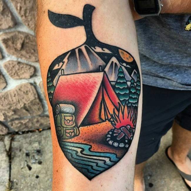 Magnificent acorn shaped forearm tattoo stylized with night camping