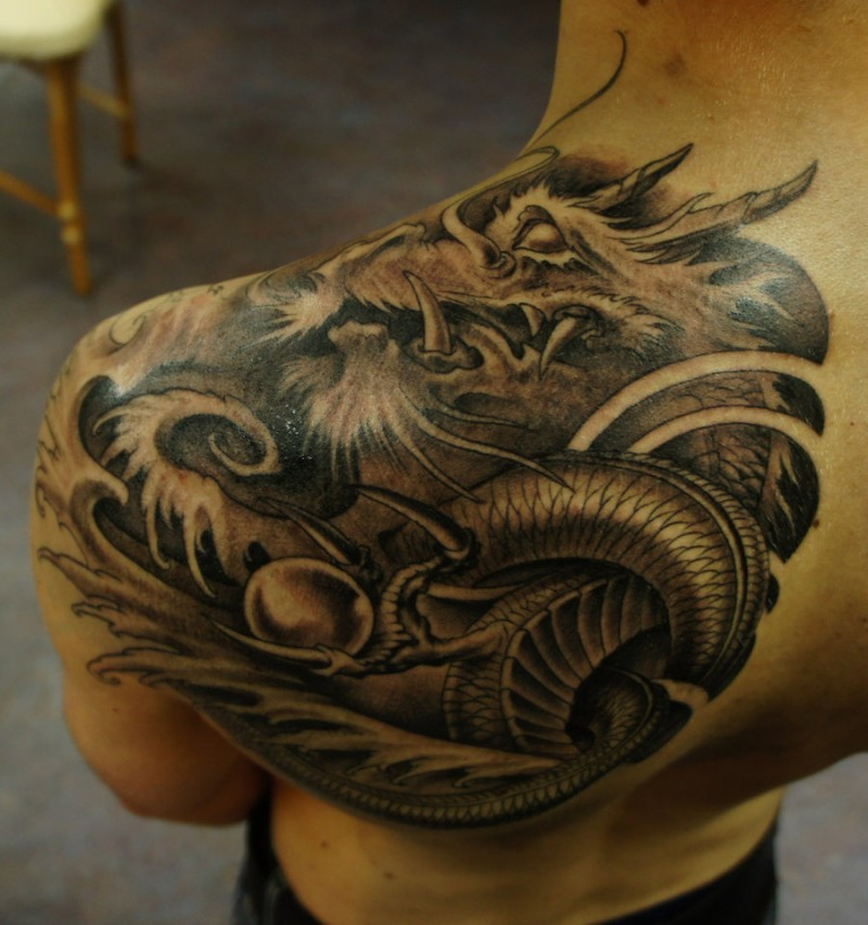 Magnificent Asian style very detailed black ink shoulder tattoo of big dragon