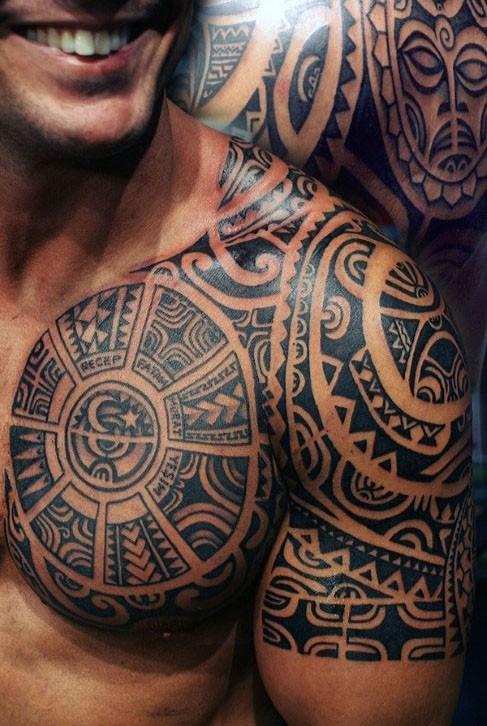 Magnificent black ink Aztec ornaments with lettering tattoo on chest and shoulder