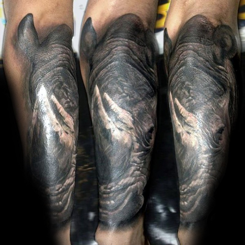 Magnificent colored and detailed forearm tattoo of big rhino head