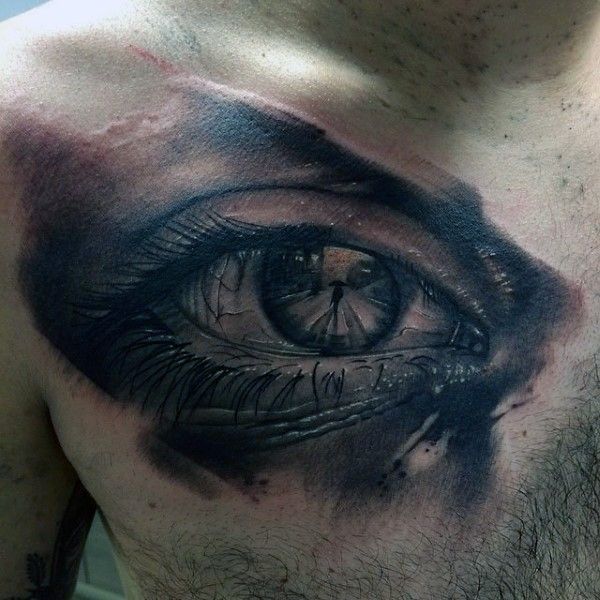 Magnificent colored chest tattoo of woman eye