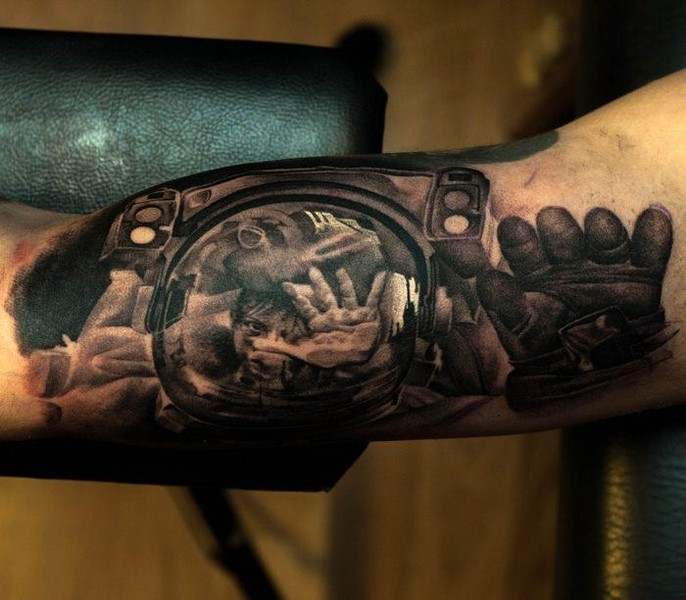Magnificent creepy designed black ink arm tattoo of spaceman