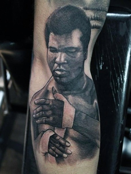 Magnificent designed and painted black ink Muhammad Ali portrait tattoo on leg