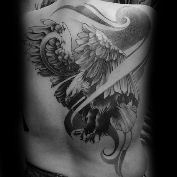 Magnificent designed massive detailed flying eagle tattoo on upper back