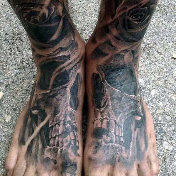 Magnificent designed very detailed skull with flowers tattoo on legs
