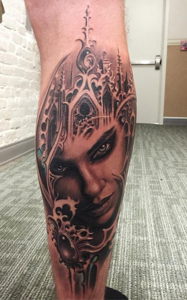 Magnificent detailed colored woman portrait tattoo on leg stylized with magic castle