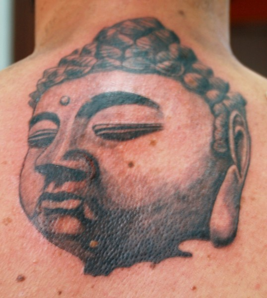 Magnificent huge Buddha&quots portrait with closed eyes upper back Buddhist tattoo
