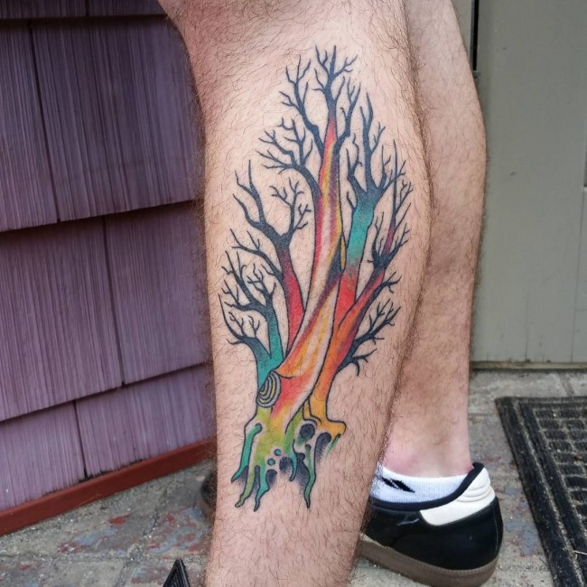 Magnificent multicolored leg muscle tattoo of fantasy tree