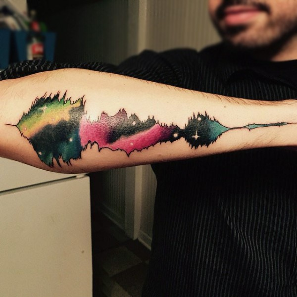 Magnificent multicolored space lie music wave tattoo on arm