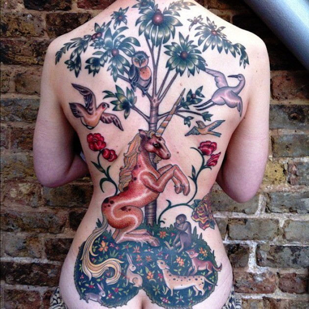 Magnificent multicolored whole back tattoo of various fantasy animals