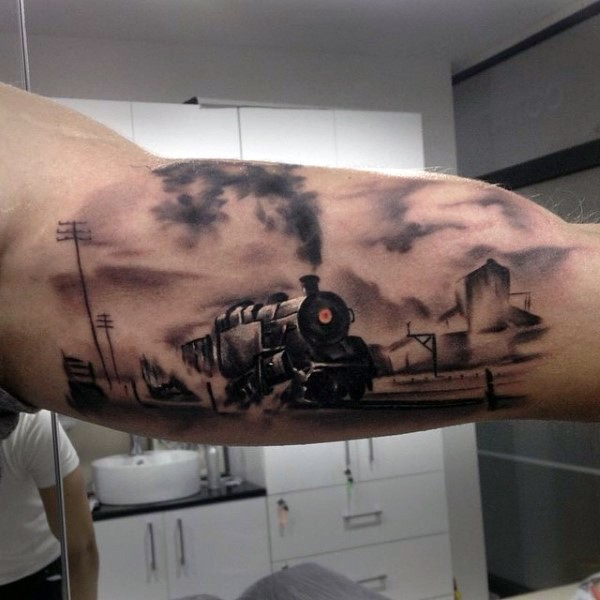 Magnificent painted and colored old western train tattoo on arm
