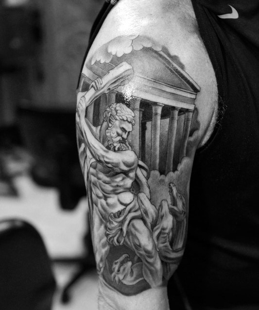 Magnificent painted antic Greece warrior with building tattoo on arm