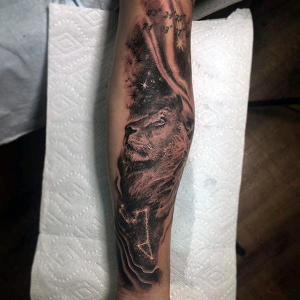 Magnificent painted black and white lion with lettering and stars tattoo on arm