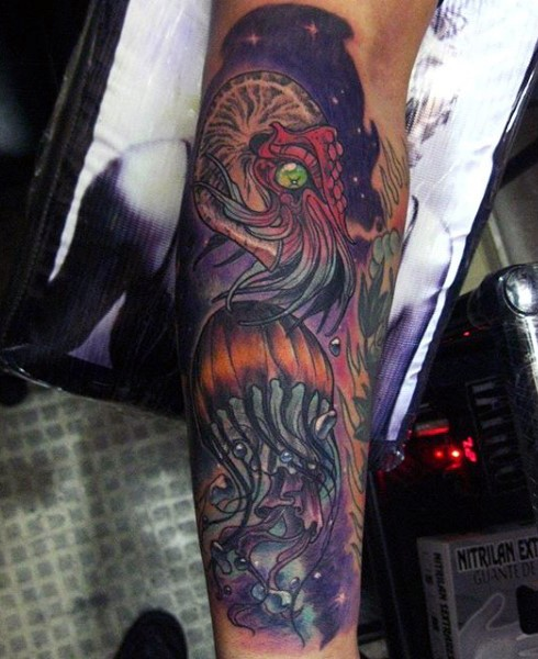 Magnificent painted multicolored alien like jellyfishes tattoo on arm