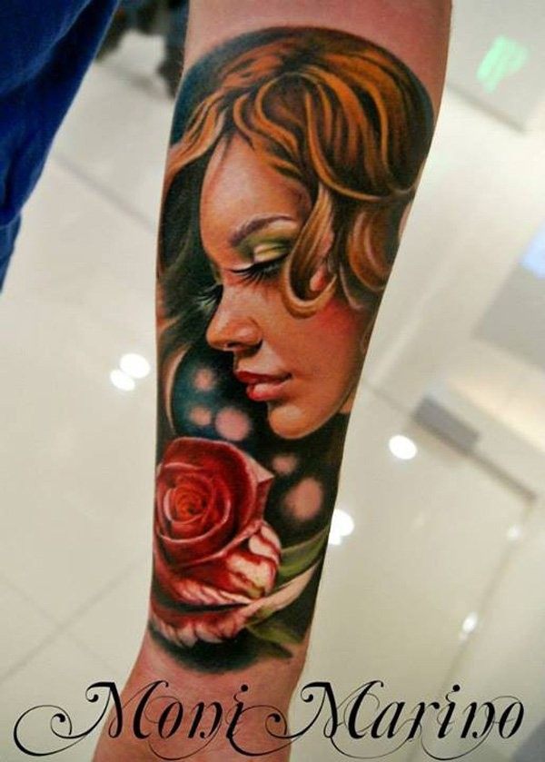 Magnificent painted very detailed beautiful woman with rose tattoo on arm