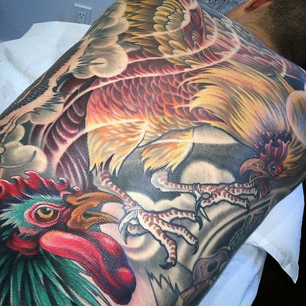 Magnificent painted very detailed colorful cock fight tattoo on whole back