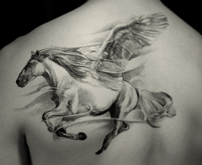 Magnificent splendid mysterious big size Pegasus tattoo on man's upper back with haze