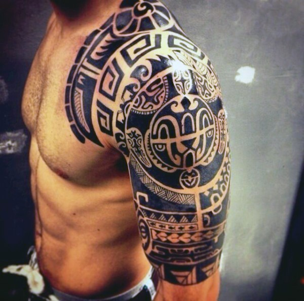 Magnificent very detailed black ink shoulder tattoo of Polynesian ornaments