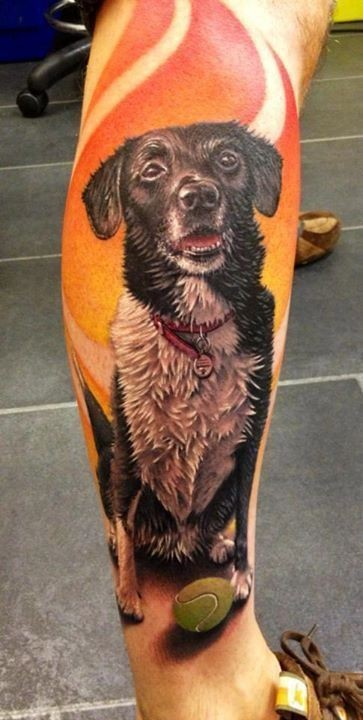 Magnificent very detailed natural colored leg tattoo of old dog portrait
