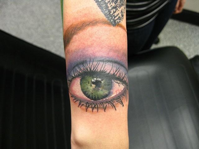 Makeup eye forearm tattoo