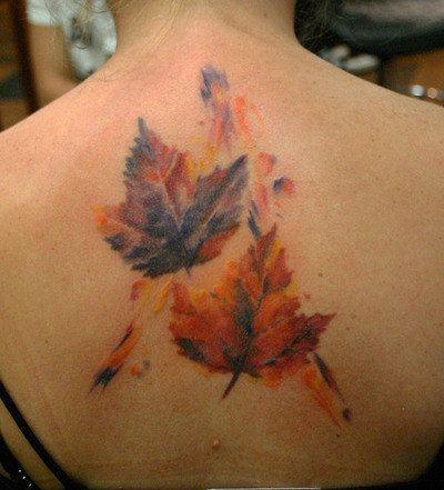 Maple leaves tattoo on upper back