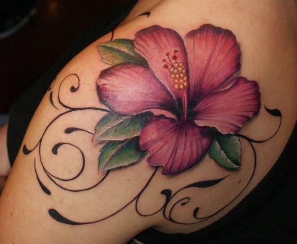 Maroon hibiscus flower tattoo on shoulder blade