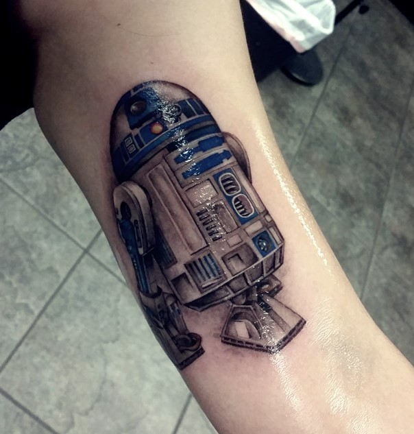 Marvelous 3D style very detailed arm tattoo of R2D2 droid