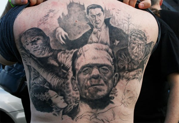 Marvelous big black and white realistic old horror movies heroes tattoo on upper back