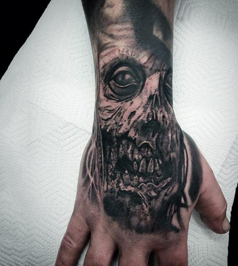 Marvelous black and white detailed horror zombie face tattoo on hand