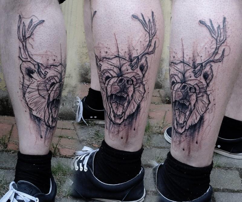 Marvelous black ink leg tattoo of bear head with deer horns