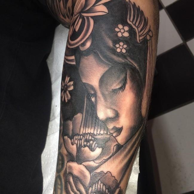 Marvelous black ink sleeve tattoo of cute Asian geisha portrait and flowers